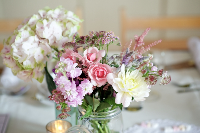 Vintage jars filled with pastel  prettiness - hydrangea, roses, stocks, mint flowers, astilbe and astrantia.